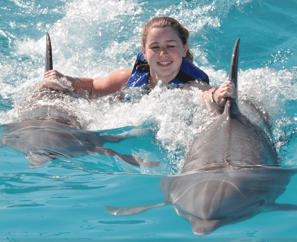 Smile Dolphin Ride with 2 dolphins in Mexico